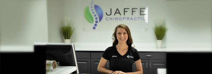 Chiropractic Charlotte NC Front desk greeting patients